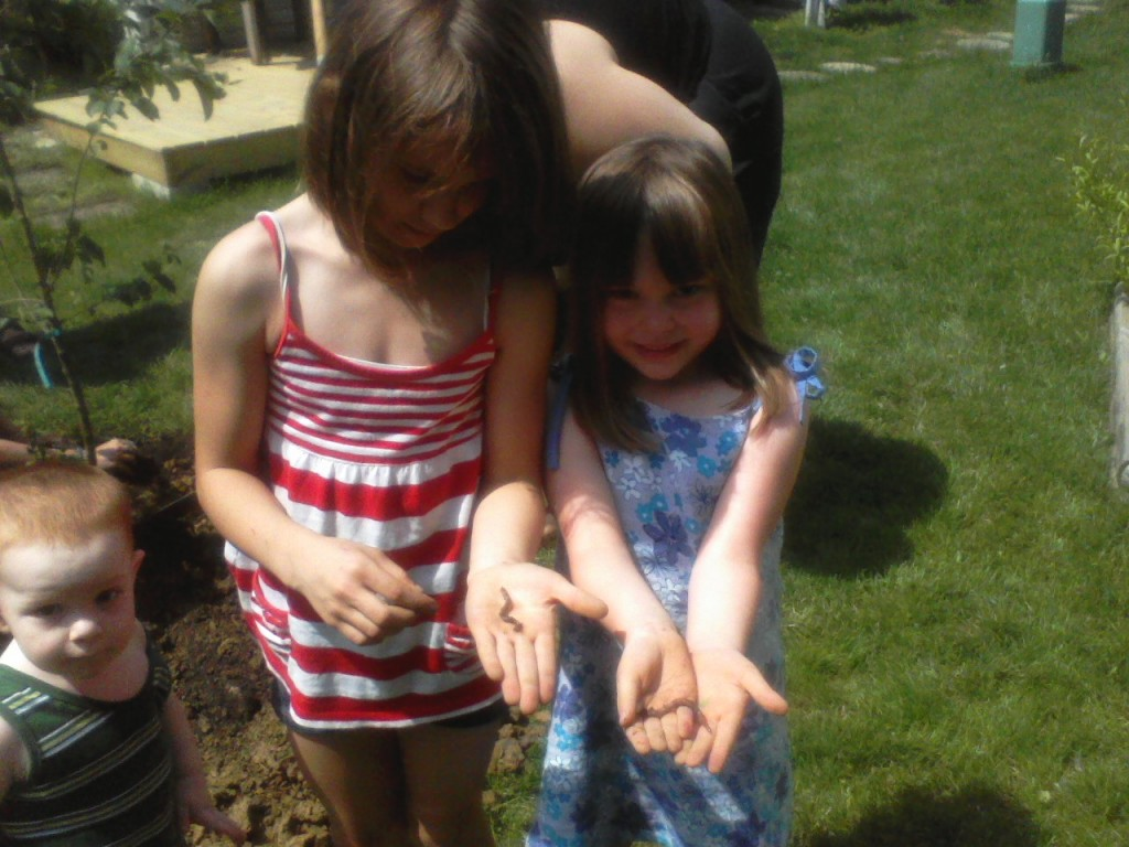 Kids rescuing worms